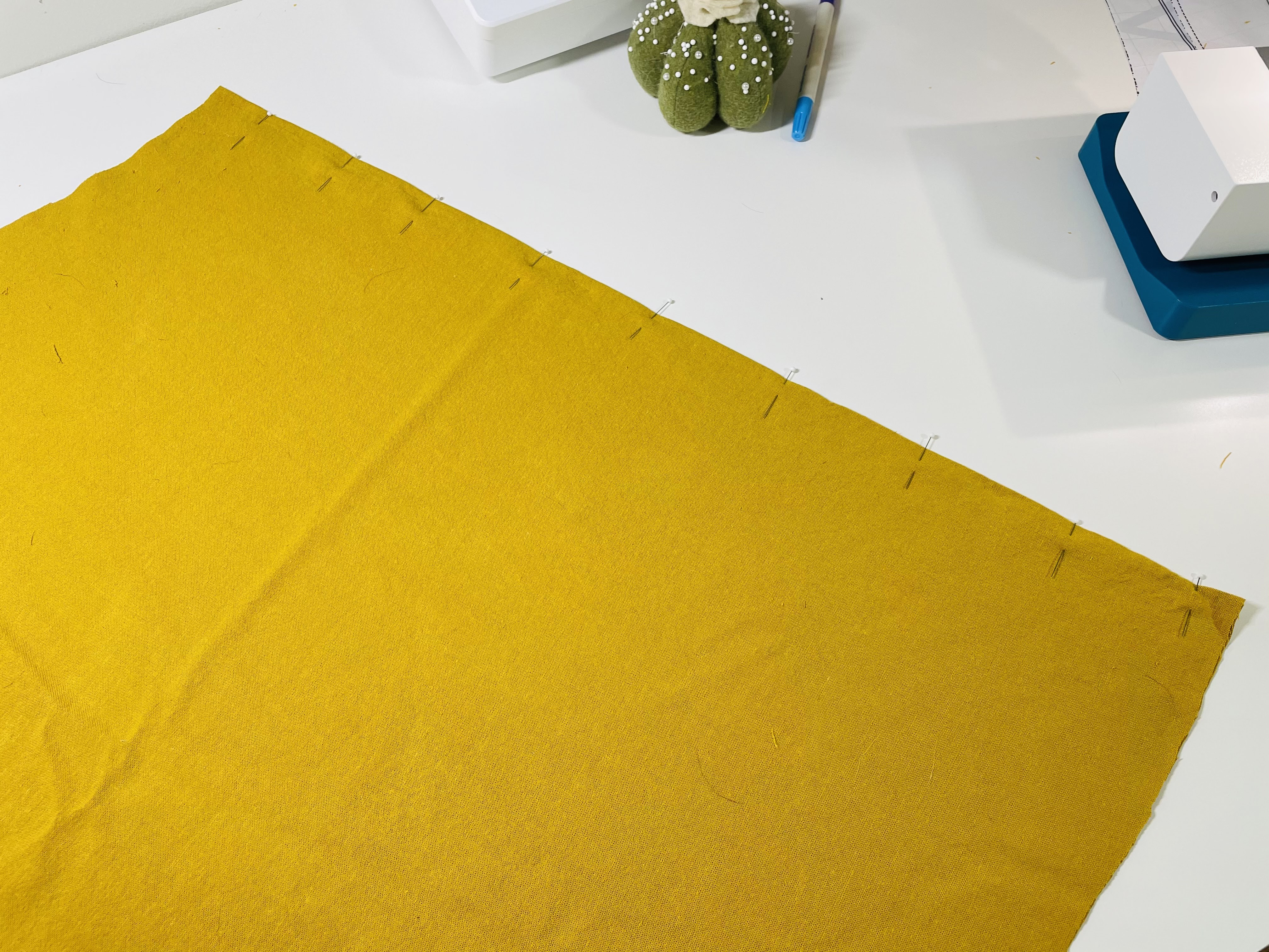 A skirt is pinned along the center back seam, right sides together